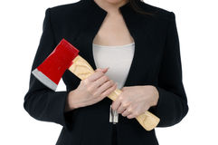 Close-up of a businesswoman carrying an axe Stock Images