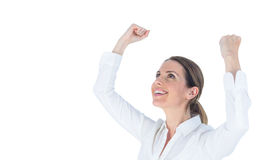 Close up of a businesswoman cheering with arms up Stock Image
