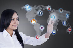 Close-up businesswoman connects to social network. Close-up of businesswoman clicking on socical network icon Stock Images
