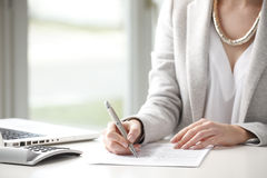 Close-up of businesswoman fill a form. Royalty Free Stock Photos