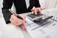 Businesswoman Hand Calculating Business Report royalty free stock photo