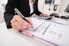 Businesswoman Hand Calculating Business Report stock photos