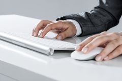 Closeup of businesswoman hand typing on keyboard with mouse on w stock photography