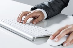 Closeup of businesswoman hand typing on keyboard with mouse on w royalty free stock images