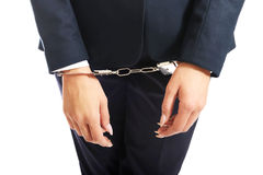 Close up on businesswoman with handcuffs Royalty Free Stock Photography