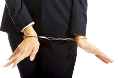 Close up on businesswoman with handcuffs Royalty Free Stock Images