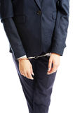 Close up on businesswoman with handcuffs Royalty Free Stock Photos
