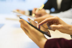 Close-up of Businesswoman hands working with tablet pc during a Royalty Free Stock Photography