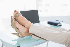 Close up of a businesswoman in high heels relaxing with feet up Royalty Free Stock Image