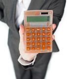 Close-up of a businesswoman holding a calculator Royalty Free Stock Image