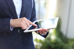 Close-up of businesswoman holding digital tablet Stock Images