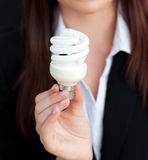 Close-up of a businesswoman holding a light bulb Royalty Free Stock Photos