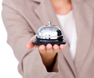 Close up of a businesswoman holding service bell Stock Photography