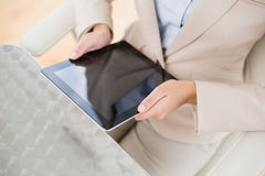 Close up of a businesswoman holding a tablet pc Stock Photo