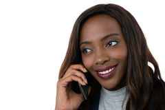 Close up of businesswoman looking away while talking on mobile phone Royalty Free Stock Photos