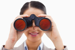 Close up of a businesswoman looking through binoculars Royalty Free Stock Photo