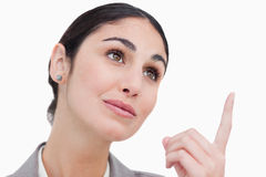 Close up of businesswoman looking and pointing up Stock Photos