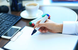 Close-up of Businesswoman makes a note Royalty Free Stock Photography