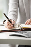 Close-up of a businesswoman making note Royalty Free Stock Images