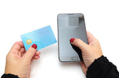 Close-up Of Businesswoman Paying With Credit Card On Mobile Phon Royalty Free Stock Photography