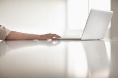 Close up of businesswoman's arm using her laptop in the office Stock Photography