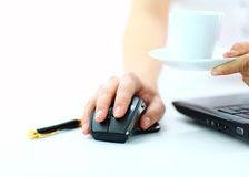 Close-up of businesswoman's hand on mouse Royalty Free Stock Images