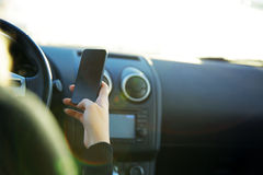 Close-up of a businesswoman sending a text while driving Stock Photography