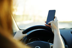 Close-up of a businesswoman sending a text while driving Royalty Free Stock Photos