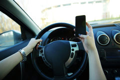 Close-up of a businesswoman sending a text while driving Royalty Free Stock Image