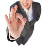 Close-up of a businesswoman showing OK sign Royalty Free Stock Photography