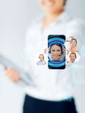 Close up of businesswoman showing smartphone Royalty Free Stock Images