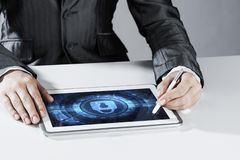 Internet security concept with woman working on media screen with stylus. Close up of businesswoman sitting at atble and working on tablet pc stock photo