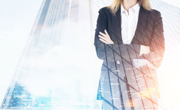 Close up of businesswoman and skyscraper Stock Image
