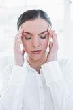 Close up of businesswoman suffering from headache Stock Photo