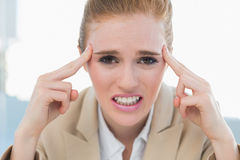 Close up of businesswoman suffering from headache Stock Photography