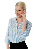 Close-up of a businesswoman talking on phone. Businesswoman talking on phone and smiling at camera Stock Images