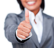 Close-up of a businesswoman with thumb up Stock Photo