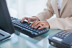 Close up on businesswoman typing on her keyboard Royalty Free Stock Photography