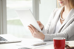 Close-up of businesswoman is typing on her tablet Stock Photo