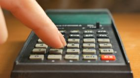 Woman Businessman using a calculator hands doing an account. Close-up of businesswoman using calculator. Secretary hands working with calculator. Manicure of stock video footage