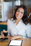 Close-up of businesswoman using digital tablet in café Royalty Free Stock Photography