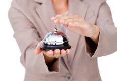 Close-up of a businesswoman using service bell Royalty Free Stock Image