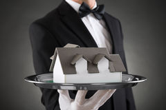 Close-up Of Butler With House Model. On Stainless Steel Tray stock photos