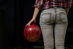 Close-Up Of A Butt Next To A Bowling Ball Stock Photos
