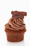 Close up of buttercream chocolate cupcake with chocolate sticker Stock Images