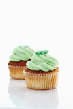 Close up of buttercream woodruff cupcake against white backgroun Royalty Free Stock Photography