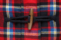 Close-up of button on checkered coat Royalty Free Stock Images