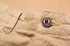 Close up of button on pants Stock Image