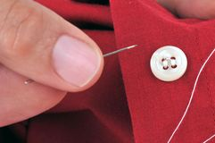 Close up a button in close-up. Sew a shirt button in close up royalty free stock photo