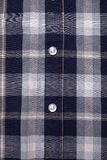 Close-up of buttons on checked shirt Royalty Free Stock Photos
